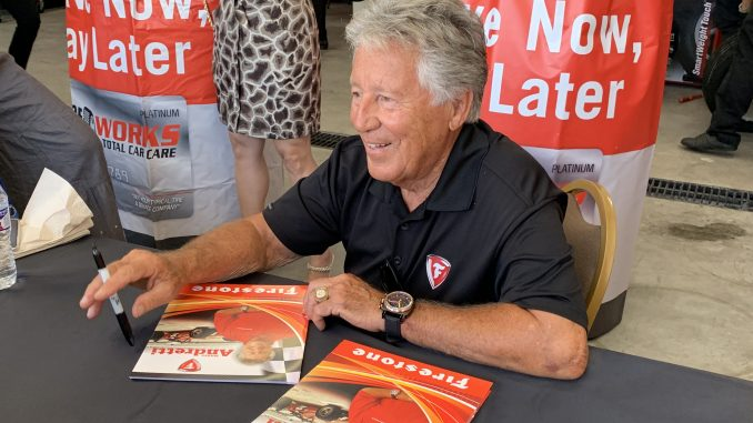 PHOTOS: Racing legend Mario Andretti meets fans at new Tire Works